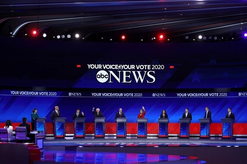 Democratic candidates gather for a televised debate. Photo Credit: Vox.com