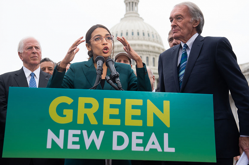 Representative Ocasio-Cortez speaks passionately about the Green New Deal alongside its co-sponsor Senator Markey on Capitol Hill in 2019. [Photo Credit: POLITICO]
