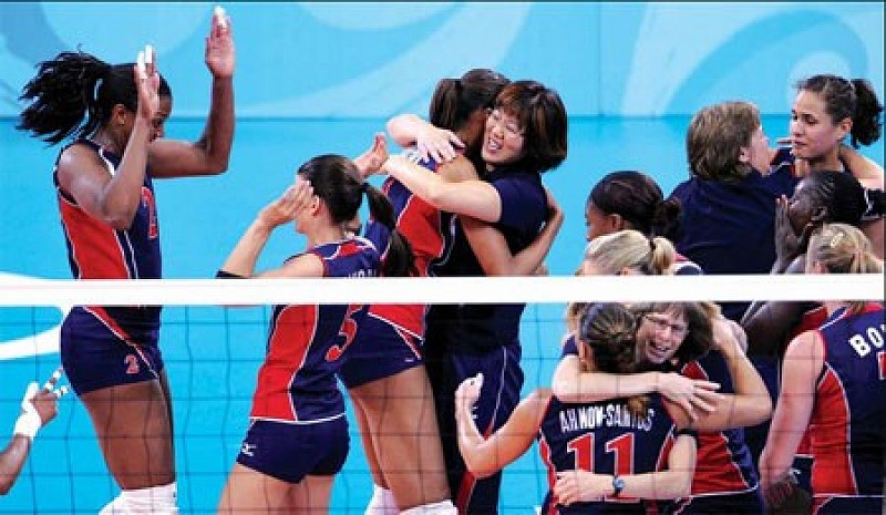 After beating Cuba in the semi-finals, Lang celebrates with the American team. [Photo Credit: China Daily]