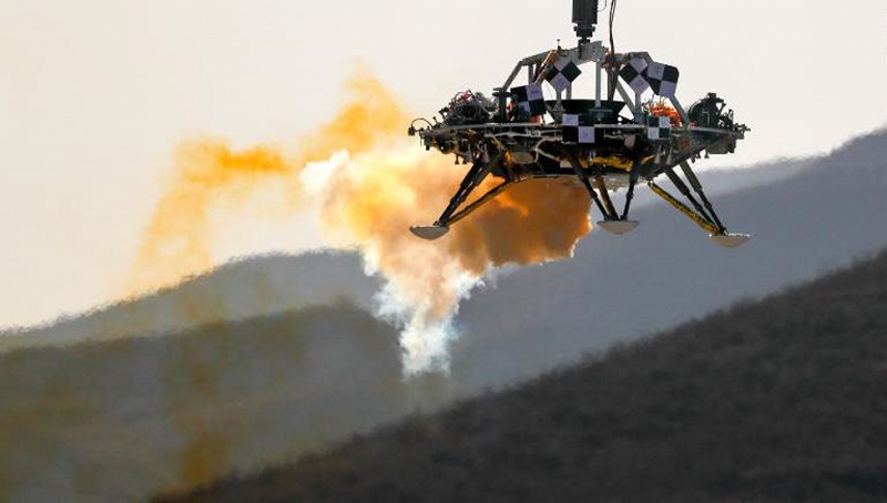 A lander is lifted during testing at a facility in Huailai. [Photo credit: Andy Wong/Associated Press]
