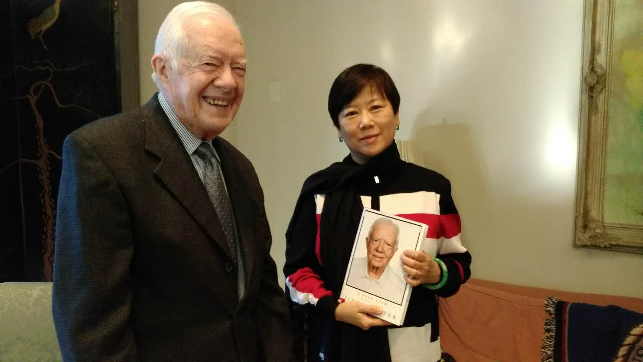 Former President Carter presents his book to Madame Li Xiaolin and speaks at the opening ceremony of the 2016 Forum