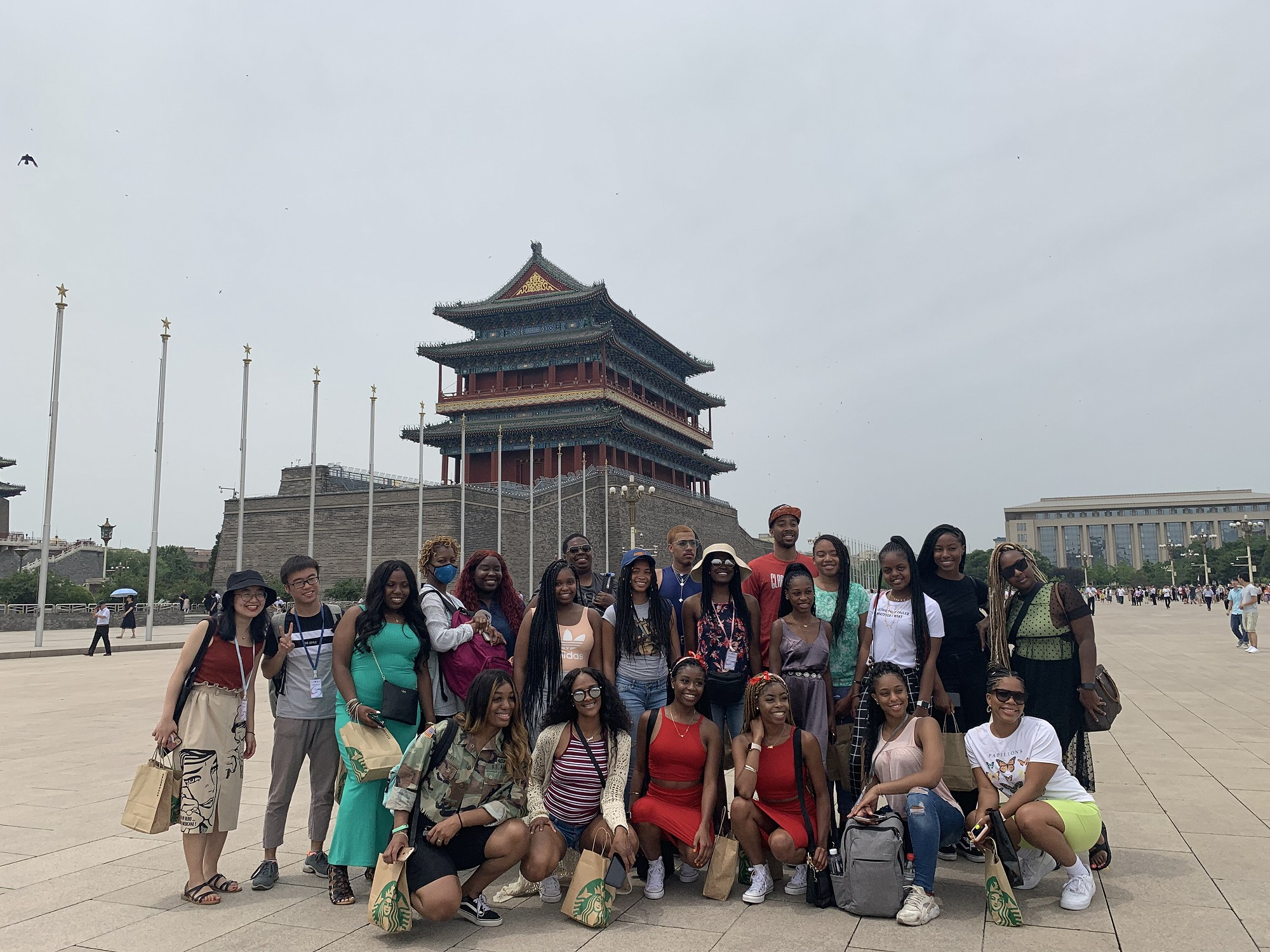 Clark Atlanta University (CAU) students and BFSU student volunteers group picture near Tiananmen Square.