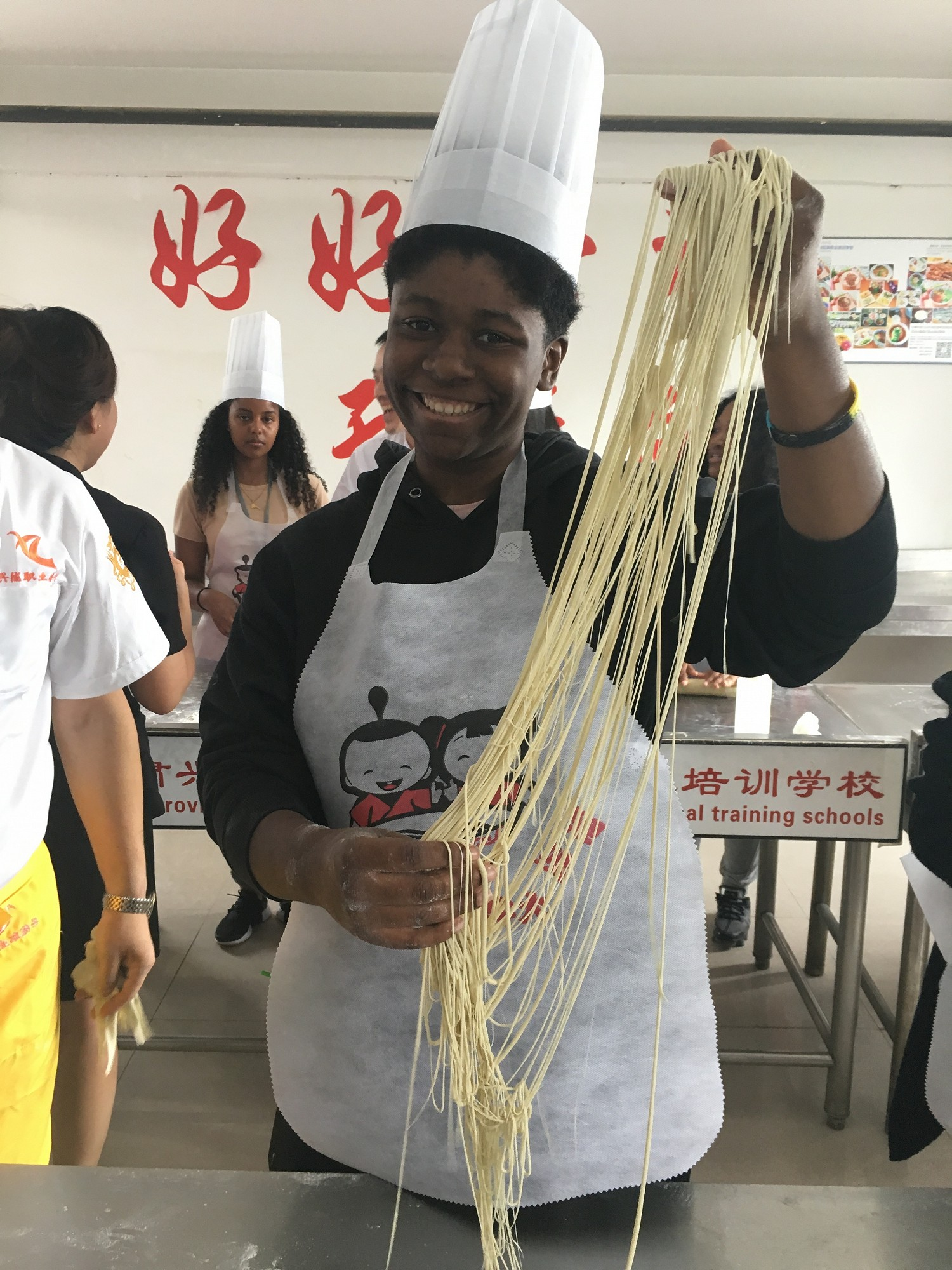 Peralta student experience traditional noodle making at a culinary school in Lanzhou