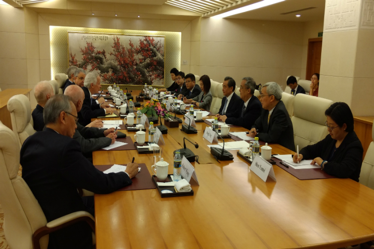 U.S. delegation meets with Minister Wang Yi (left) and visits the National Defense University (right)