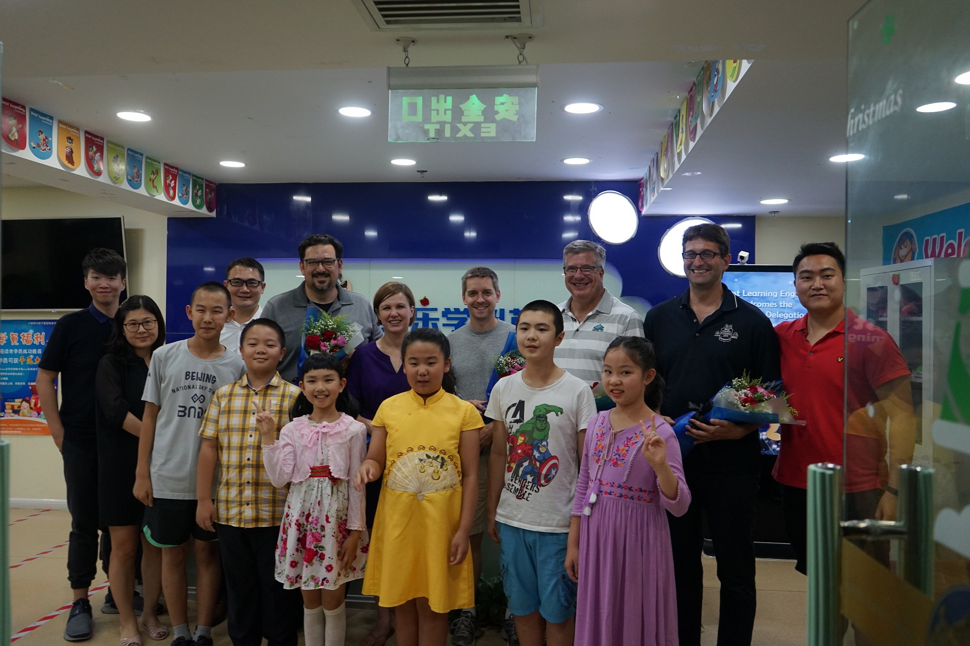 The delegation meets with young students during their visit to an English Learning Center in Beijing
